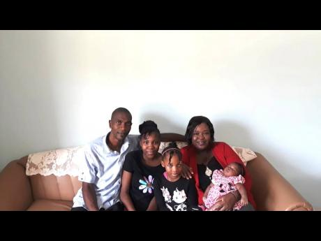 Danyelle (second left) with her father Tyrone, Mother Nardia and siblings Daneillia and Daneira.