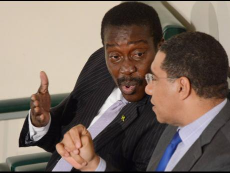 Jamaica Labour Party  Leader Andrew Holness  (right) and  party Chairman  Robert Montague.