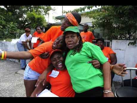People's National Party and Jamaica Labour Party supporters frolic on the road during the March 2012 local government elections. Concerns over COVID-19 infections have put the issue of tougher gathering protocols on the national agenda.