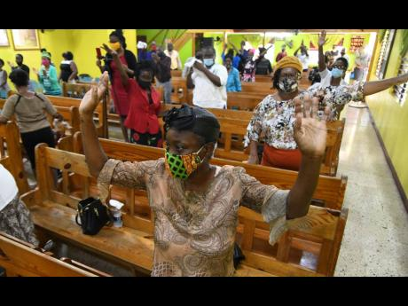 Worshippers at Shiloh Apostolic Church wear masks and observe social distancing during the Sunday service at Church Street in Kingston.