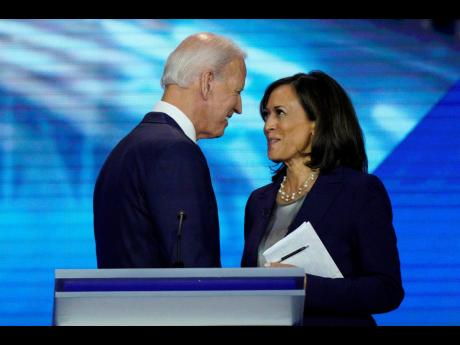 In this September 12, 2019, file photo, Democratic presidential candidate Joe Biden speaks with then candidate Senator Kamala Harris. Biden confirmed on Tuesday that she would be his running mate.