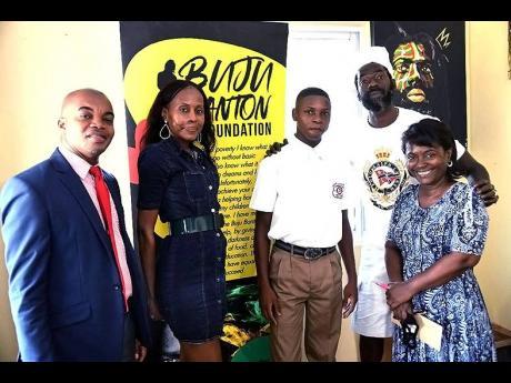 From left, Donovan Hunter, principal, Denham Town High School; Rosemary Duncan, director, Buju Banton Foundation; Tajay Bailey, scholarship recipient; Buju Banton and  Denese Callum, teacher, Denham Town High School.