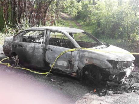 The car in which the burnt body of Tonia McDonald was found with the throat slashed at Sherwood Forest, Portland.