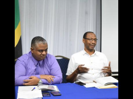 Robert Kinlocke (right) was a member of the managing committee of the Shipping Association of Jamaica (SAJ) and is pictured making valuable contribution to an annual general meeting of the SAJ. Also pictured are Andre Rochester of Maritime and Transport Se