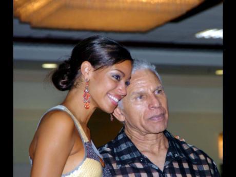 Miss Jamaica World 2008 Yendi Phillipps with Mickey Haughton James.