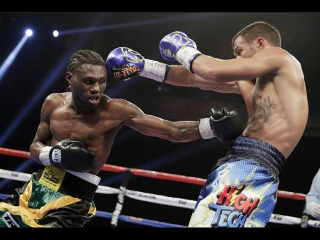 Vasyl Lomachenko (right) of Ukraine, dodges a punch by Nicholas Walters during a WBO junior lightweight title boxing match on Saturday, November 26, 2016, in Las Vegas.
