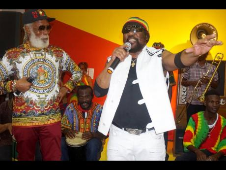 Big Youth (left) and Toots share the stage at the opening  of the 'Jamaica Jamaica' exhibition at the National Gallery on February 2, 2020.