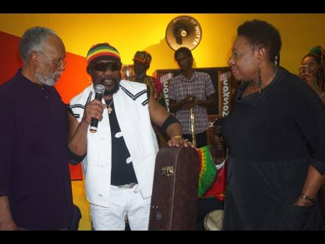 From left, Herbie Miller, Director of the Jamaica Music Museum, Toots Hibbert, and  Olivia Grange, Minister of Culture, Gender, Entertainment and Sport at the opening of the 'Jamaica Jamaica' exhibition at the National Gallery in February.