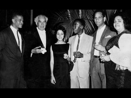 Sir Alexander Bustamante (second left) with members of the Guild Council of The University of the West Indies, who were among his guests at the reception at Vale Royal for then Prime Minister of Trinidad and Tobago Dr Eric Williams. From left: Selvyn Walte