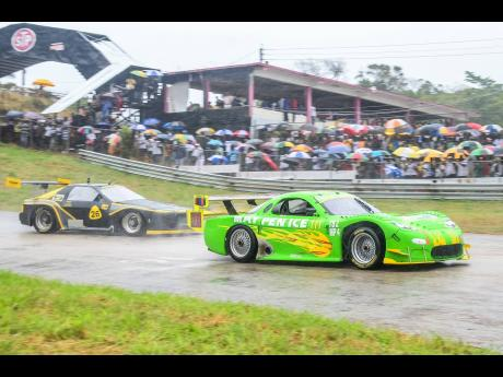 Two generations of the classic Mazda RX7 tackling the wet surface at Dover.