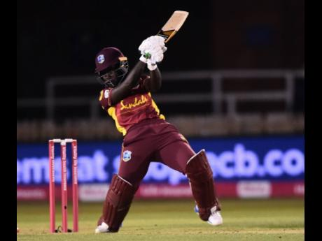 Windies Women batter Deandra Dottin in action against England Women during their first Twenty20 International in their five-match series at the County Ground in Derby, England, yesterday.