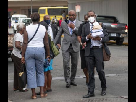 St Catherine South Central Member of Parliament Dr Andrew Wheatley (second left) and attorney-at-law Chukwuemeka Cameron (second right) make their way to the Supreme Court in downtown Kingston on Friday, August 1.