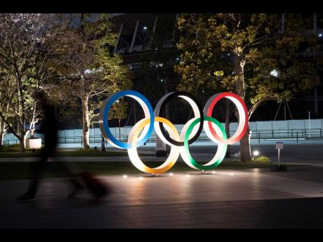 The Olympic rings are seen Monday, March 30, 2020, in Tokyo. The Tokyo Olympics will open next year in the same time slot scheduled for this year's games. Photo/Jae C. Hong)