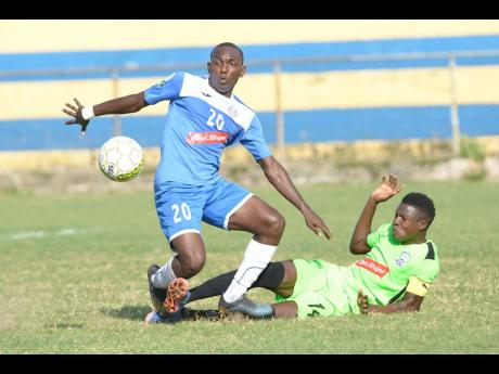 Sergeni Frankson (right) of Molynes FC challenges Rondee Smith of Portmore United during a Red Stripe Premier League match at the Constant Spring Field on Sunday, December 8, 2019.