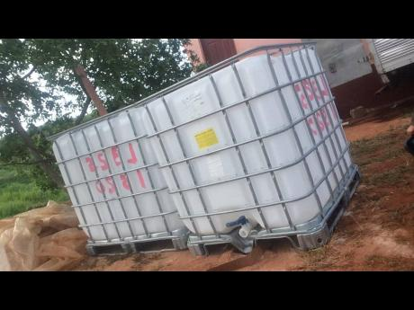 Two of the water tanks purchased for some farmers in Manchester and St Elizabeth through the New Zealand High Commission Fund.