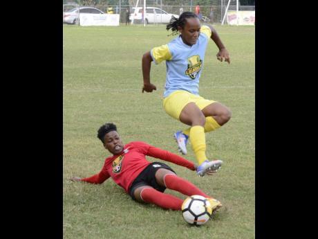 Action between Arnett Gardens Women's FC  and Waterhouse Women's FC during the Jamaica Football Federation Women's League mid-season final at Winchester Park on Sunday, August 19, 2018.