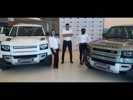 Unveiling the new Defender are (from left): Jackie Stewart Lechler, managing director, Stewart Auto Gallery; Andrew Badaloo, sales executive, Stewart Auto Gallery; and Nedita Gibson, brand manager, Stewart Auto Gallery.