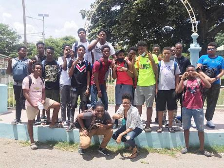 The 25 tenth-graders at St George's College who aced CSEC maths pose with their teacher, Maliya Rabathaly-Llewellyn.