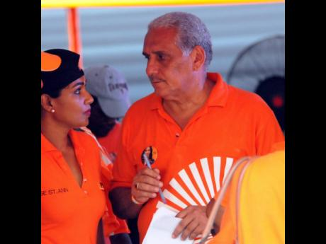 Richard Lake speaks with partner Lisa Hanna in an internal election on September 17, 2016. The couple has since got married.