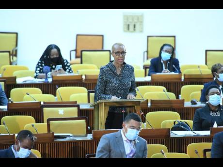 Fayval Williams, minister of education, makes an address during a sitting of the House of Representatives at the Jamaica Conference Centre in Kingston on Tuesday.
