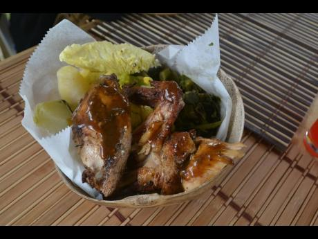 Jerk chicken with breadfruit and callaloo.