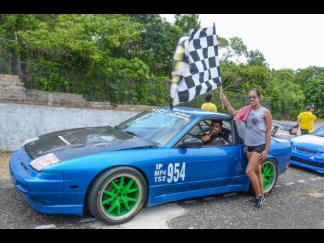 Catherine Chock is the biggest fan whenever husband Kevin is on or off track.