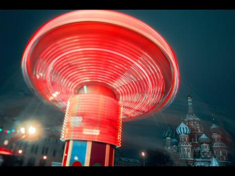 Merry-go-round in Red Square, Moscow, on New Year's eve, with St Basil's Cathedral in the background.