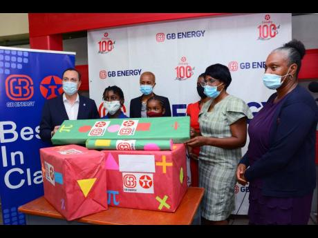 Jennifer Solomon, principal of August Town Primary School, accepts J$100,000 worth of Math Resources from Bela Szabo, CEO of GB Energy Texaco Jamaica. Looking on from (from left) are: Esther Roxborough, student of the school;  Fayval Williams, Minister of