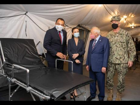 From left: Health and Wellness Minister Dr Christopher Tufton touring the COVID-19 field hospital on the grounds of the National Chest Hospital with Foreign Affairs Minister Kamina Johnson Smith, United States Ambassador Donald Tapia, and Admiral Craig Fa