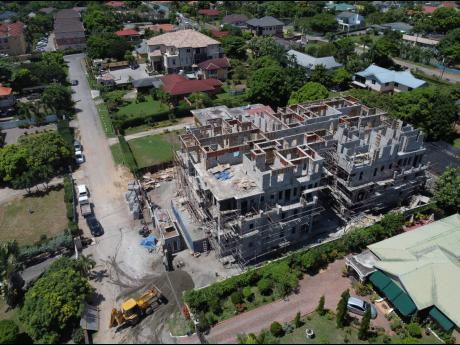 An aerial view of the construction of a multifamily dwelling at 9 Evans Avenue in St Andrew