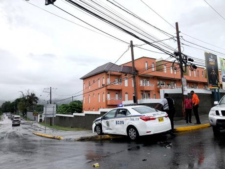 The accident scene at Central Avenue and Constant Spring Road involving a police service vehicle around 2 p.m. on Tuesday.