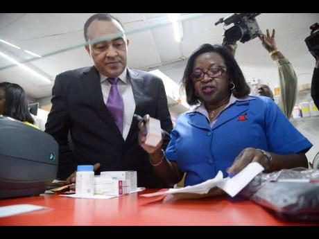 Ernestine Watson, president of the Pharmaceutical Society of Jamaica, seen here with Health Minister Dr Christopher Tufton in February 2017.