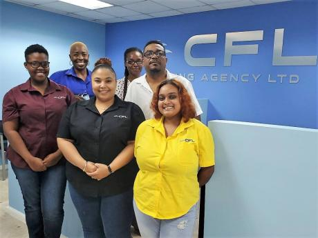 Kingston Team Back row (from left): Consolidated Freight Line Shipping Jamaica's General Manager Stacia Nosworthy Cunningham, accounts clerk Latoya Lue, Financial Controller Andrew Payne. Front row (from left): customer service representative Ronique Sha