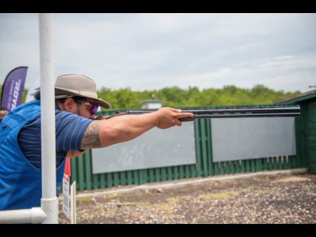 Alex Cunningham lines up a shot during a charity sporting clays event held at the Jamaica Skeet Club on Sunday, May 26, 2019.
