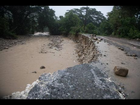 Silt covers the Georgia main road in St Thomas as a section A section of the roadway is being eroded by a river on Friday October 2. The NWA boss has noted the physical damage caused to road by landslides but says most of the roads being eroded across the