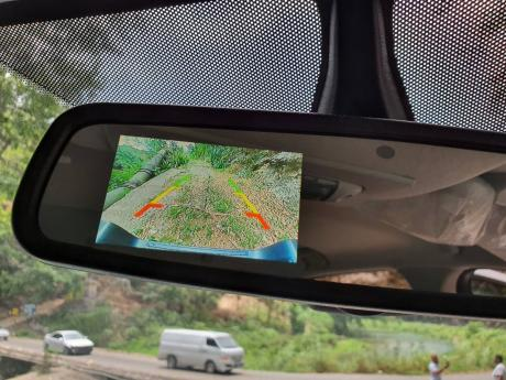 Tech features include the reversing camera located in the rear view mirror.