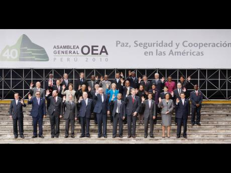 In this 2010 photo Jamaica's Ambassador to the United States, Audrey Marks (fourth right, second row), with foreign ministers and officials pose for the official photo of the 40th General Assembly of the Organization of American States in Lima, Peru. Th