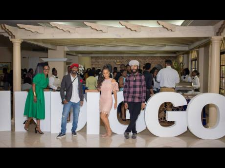 From left: Kerry-Ann Clarke, Corey Mus, Kamila McDonald, and Protoje have fun at the inaugural staging of the INDIGGO Conference in 2018.