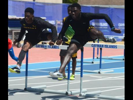 Jamaican sprint hurdlers Vashaun Vascianna (right) and Neil Sutherland go through their paces during a training session ahead of the start of the Carifta Games at the Truman Bodden Sports Complex in The Cayman Islands last year.