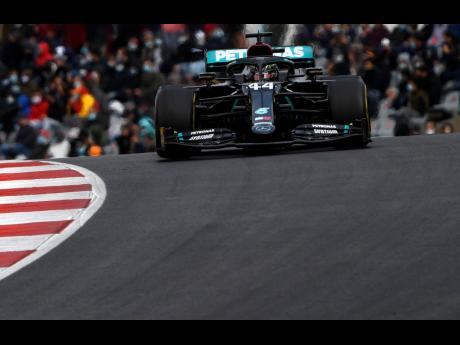 Mercedes driver Lewis Hamilton of Britain on his way to his record-setting 92nd victory during the Formula One Portuguese Grand Prix at the Algarve International Circuit in Portimao, Portugal, yesterday.