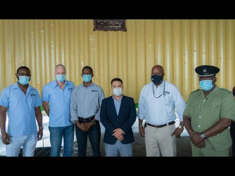 Minister without portfolio in the Ministry of National Security, Matthew Samuda (third right), with (from left) Samuel Jones, technical sales representative; Hans Muller, divisional manager, Dr Patrick Craig, veterinarian; Winston Thomas, regional sales ma