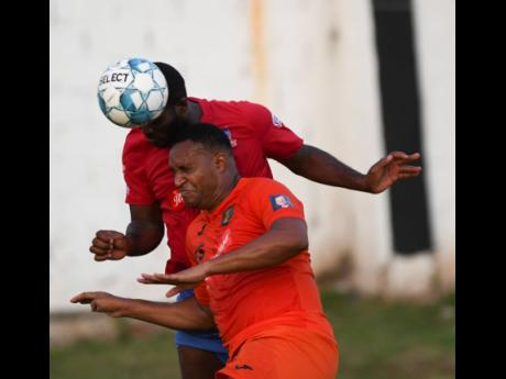 Dunbeholden's Andre Pryce and Tivoli Gardens' Newton Sterling (front) come together during a duel for an aerial ball in their National Premier League game at the Edward Seaga Sports Complex on Sunday, October 20, 2019.