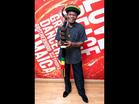 Eric Donaldson is all smiles after receiving Red Stripe's Stand Up for Our Heroes award.