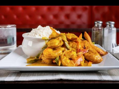 If you love curry and shrimp, tantalise your tastebuds with the scrumptious curried shrimp, served with white rice and steamed vegetables.