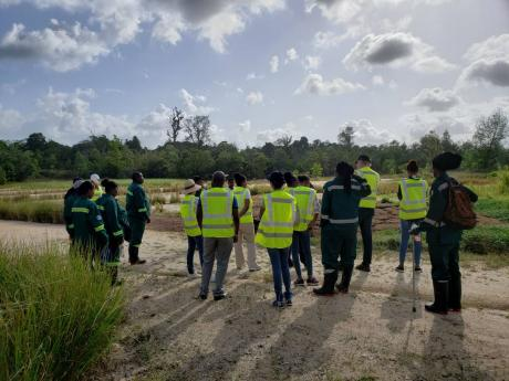 Stakeholders visit a rehabilitated quarry site in Guaico, Trinidad.