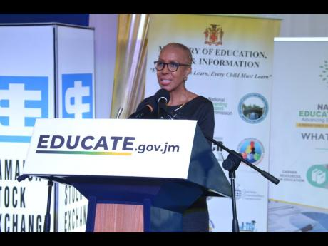 Education Minister Fayval Williams addresses the launch of the public-private-sector initiative 'One Laptop or Tablet Per Child' launch at the Jamaica Stock Exchange in downtown Kingston on Thursday.