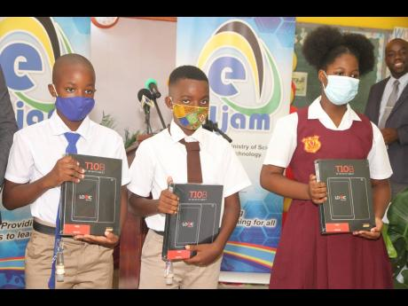 e-Learning Jamaica handed over tablet computers to students of Mocho Primary and Infant, Rock River Primary and Wood Hall Primary at Woodhall Primary in Clarendon on October 29. The students who received the tablets are (from left) Darnell Smith (Mocho Pri