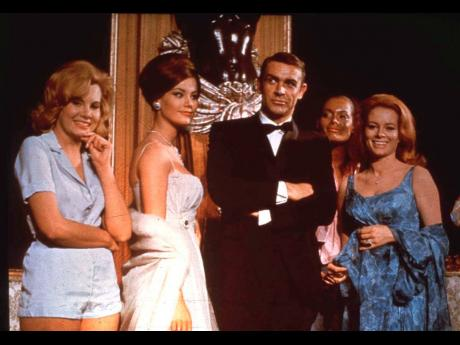 In this undated file photo, Sean Connery, as James Bond, poses in an event for the movie 'Thunderball'.