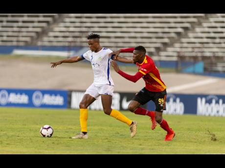 Waterhouse FC's Stephen Williams (left) is challenged by CS Herediano's Keyner Brown during their Scotiabank Concacaf League game played at the National Stadium in Kingston on Thursday, August 22, 2019.