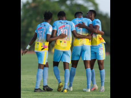 Waterhouse's Stephen Williams (third form left) celebrates a goal against Real Hope with teammates (from left) Andre Fletcher, Kendroy Howell, and Andre Leslie during the 2019 FlLOW Concacaf Caribbean Club Championhsip at Stadium East on May 14, 2019.
